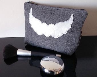 Grey fabric cosmetic bag  silver heart wings embellishment