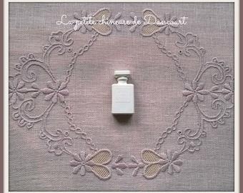 Decorative plaster shaped perfume bottle