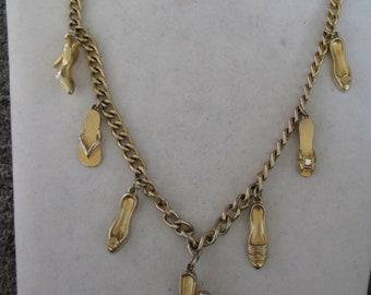 "Fun seven gold Shoe charms necklace measures 22"" long"