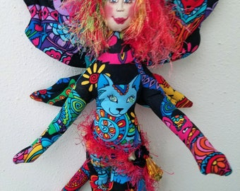 Whimsical, colorful fiber sculpted cat fairy figurine wall accent