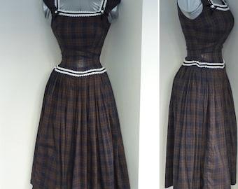 Vintage  50s sleeveless drop waist plaid dress with full skirt and velvet trim by Jerrell Jr.