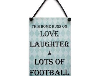 Football Gift ' This Home Runs On Love Laughter and Lots Of Football ' Handmade Home Sign 248