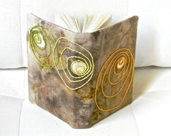CA 022:un artist book, dyed, embroidered, and sewn.