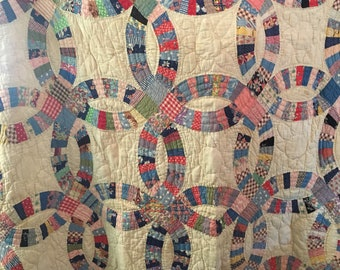 Vintage hand stitched wedding ring quilt