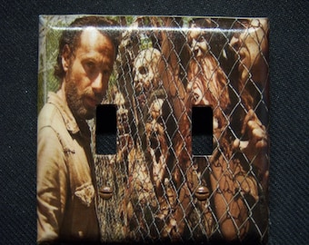 Light Switch Cover The Walking Dead - Rick with some Fenced out Zombies Print