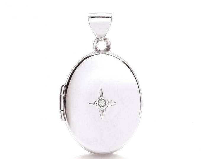 9ct White Gold Small Oval Shaped 2 Photo Locket Set With Single Diamond Hallmarked