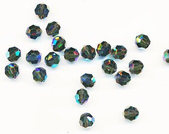 Twelve dazzling limited edition Swarovski crystals: art 5000 - 8 mm - morion AB 2X