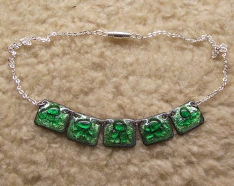 Necklace, enamel green, gray background