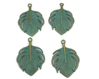 4 feather charms gold tone  and green patina, 24mm x 32mm #CH 585