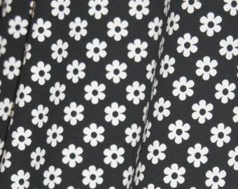 1 yard Knit black daisies