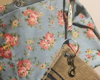 Faded flowers and rustic purse