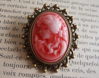 Metal with red and white cameo brooch