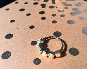Delicate sterling silver ring with opal-like stones