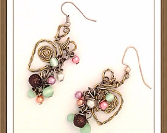 Handmade MWL forged wire shape with multi color beads. 0154