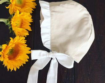 Reversible-Ruffle trim- baby bonnet