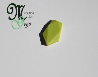 Flat green arrow shaped silicone bead.