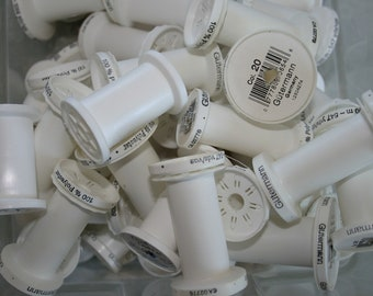 Empty plastic thread spools white grey gray gold craft supplies