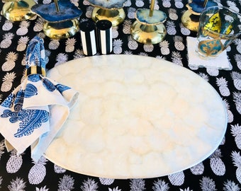 White Capiz Shell Oval Placemats with Silver Metal Trim & Cork Bases.