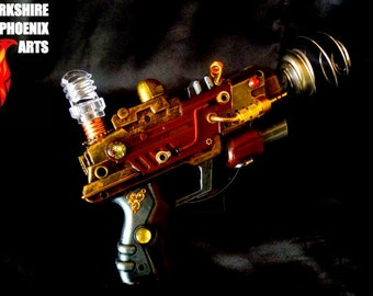 Steampunk ray gun, working battery power light, metallic colours, cables, cogs and gears, cosplay or display