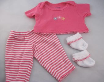 Perfect play clothes! Bright pink top with pink and white striped leggings. Also includes socks with added matching trim. Easy on and off.