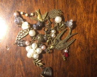 Vintage styled necklace with a charm