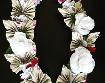 Money lei with flowers & butterfly bills