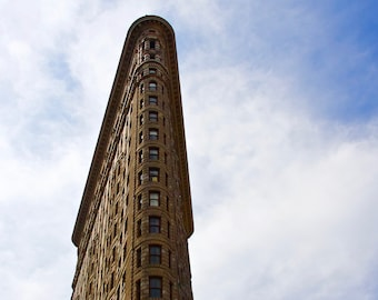 The Flatiron Building is a triangular 22-story steel-framed landmarked skyscraper located at 175 Fifth Avenue in Manhattan, New York City.