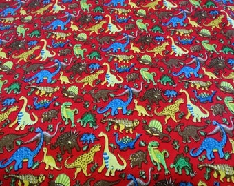 Patterns of dinosaurs red background cotton fabric
