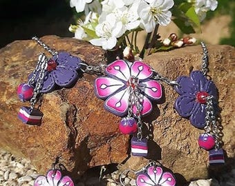 Pink and purple flowers set made of polymer clay.