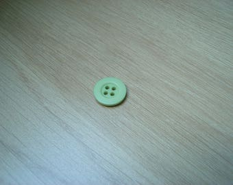 round shaped pale green button with RIM