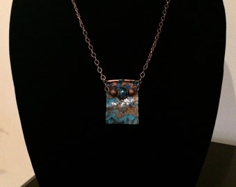 Beautiful blue patina on hammered copper with blue glass crystal and copper accents
