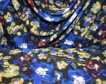 Fine Silky Jersey Lycra, flowers, Blues yellow red on black, soft draped styles,dresses tops trousers, 148 cms wide. 3.50 halfmeter 0.50cms