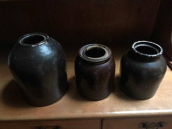 Three stoneware crocks