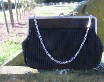 1960's black evening bag, elegant simplicity.