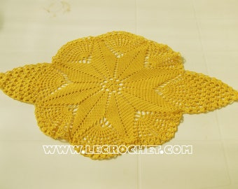 Pretty yellow oval crochet doily