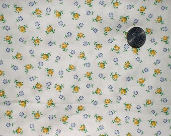 Vintage white cotton fabric with small yellow roses and tiny dark blue daisies