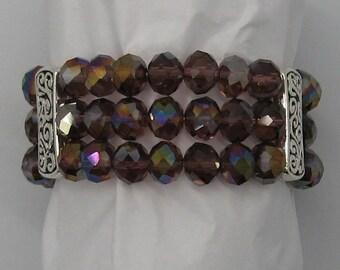 Purple bracelet, glass beads, aurora borealis, silver tone accents,elastic