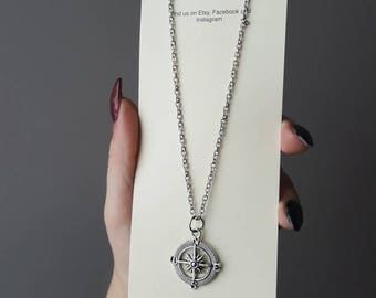 Silver compass charm pendant on silver chain necklace