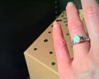 Opal solitaire sterling silver ring with 6 lavender gemstones