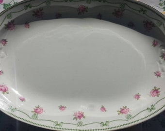 Wilkinson Ltd large platter with pink roses and bow trim.