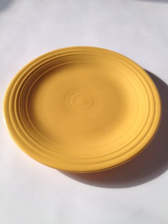 & Original unmarked fiestaware dinner plate in yellow