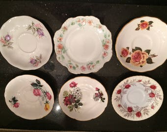 Set of six various tea saucers