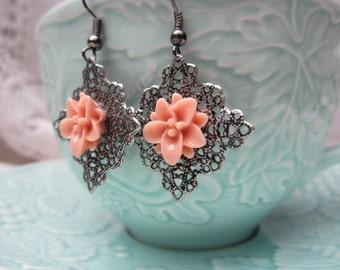 Romantic gunmetal filigree earrings with pale peach lotus flower