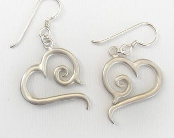 Silver Tribal Scroll Heart Earrings with a brushed finish