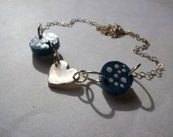 Fine silver heart necklace. Tasmanian oak rounds. Sterling silver chain.