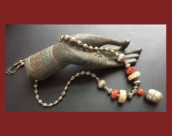 Chinese Bell: Antique silver bell, cinnabar, fossil coral, Ethiopian silver. One of a trio.