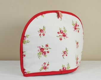 Tea cosy in cream with red flower design