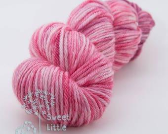 Beautiful hand dyed pink hank of DK weight superwash merino wool