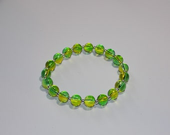 Two tone green and yellow glass bead with sterling silver spacer beads