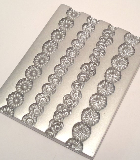Daisy Chain border mold, by lisa pavelka perfect for adding a accents and finish to your polymer clay creations.